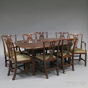 Chippendalestyle Mahogany Doublepedestal Dining Table and Eight Chairs