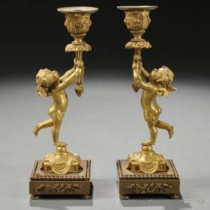 Pair of Figural Giltbronze Candlesticks