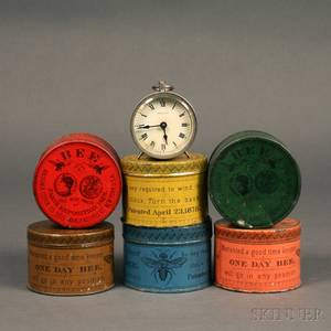 Six Ansonia Bee Shipping Tins and a Bee Clock