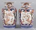 Pair of Japanese Imari palette porcelain urns 19th c