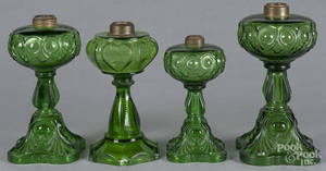 Four emerald glass fluid lamps