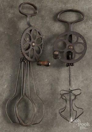Two cast iron and wire egg beaters