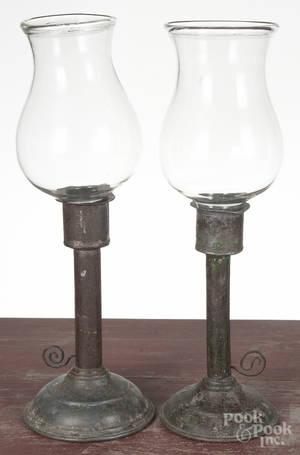 Pair of tin candlesticks