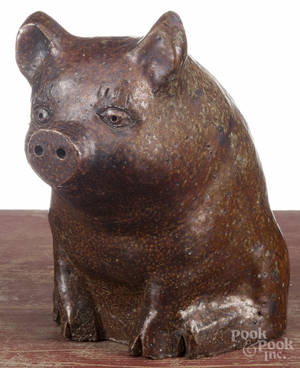 Large sewer tile seated pig