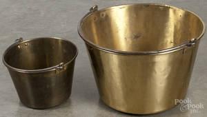 Two brass buckets
