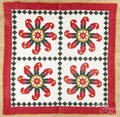 Contemporary pinwheel appliqu quilt with a diamond border