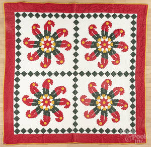 Contemporary pinwheel appliqu quilt with a diamond border