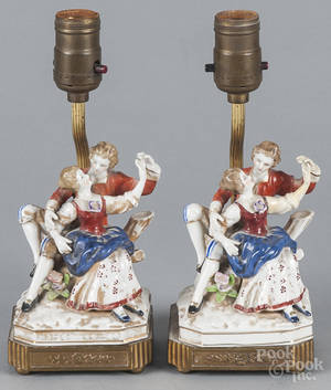 Two pairs of figural porcelain groups