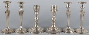 Three pairs of sterling silver weighted candlesticks