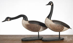 Two carved and painted Canada geese