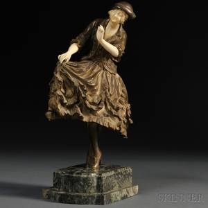 Continental School Early 20th Century Bronze and Ivory Figure of a Woman in a Cap