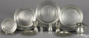 Sixteen Continental pewter plates and measures 19th c