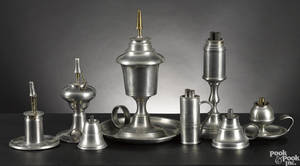 Eight American pewter fluid lamps earlymid 19th c