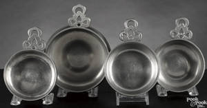 Four New England pewter porringers early 19th c