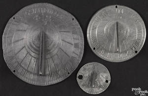 Three small pewter sundials 18th19th c