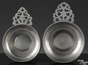 Two Connecticut or Rhode Island flower handled pewter porringers ca 1790