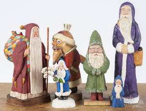 Six contemporary carved and painted Santa Claus figures