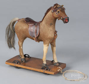 Hide covered horse pull toy