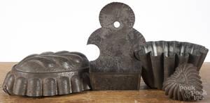 Three tin molds