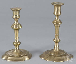 Two George II brass candlesticks