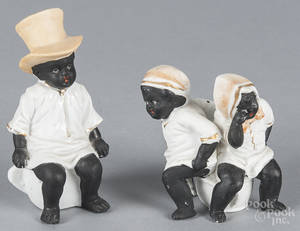 Two Black Americana bisque figures of children sitting on a chamber pot