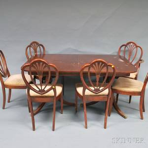 Georgianstyle Mahogany Twopedestal Dining Table and a Set of Six Shieldback Dining Chairs