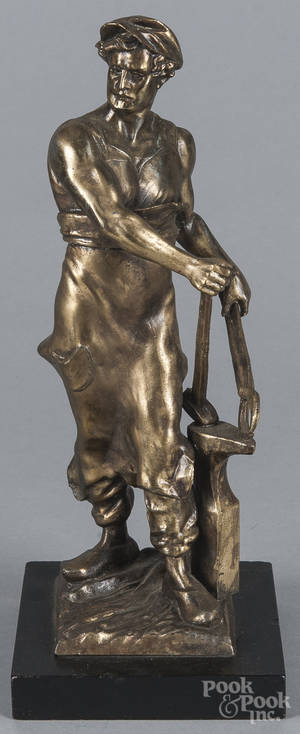 Spelter statue of a blacksmith