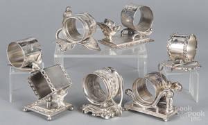 Seven silverplate figural napkin rings