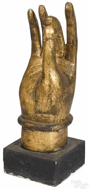 Oriental carved and gilded hand