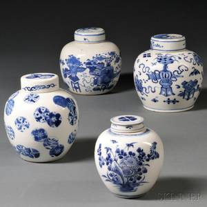 Four Small Blue and White Jars