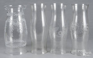 Four colorless glass hurricane shades