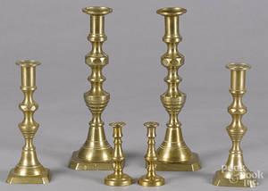 Three pairs of English brass candlesticks