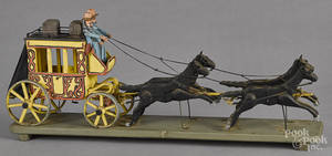 Carved and painted horse drawn stagecoach
