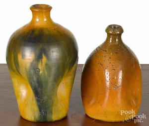 Two redware pinch bottles