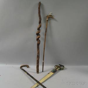 Three Carved Walking Sticks and Sword