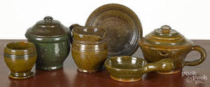 Six pieces of Stahl redware