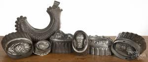 Seven tin food molds