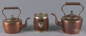 Two dovetailed copper kettles