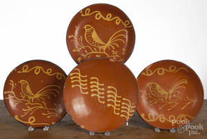 Four contemporary Greg Shooner redware plates