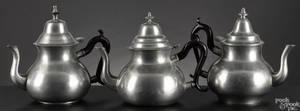 Three New England pearshaped pewter teapots earlymid 19th c