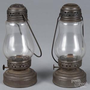 Four small tin lanterns