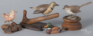 Four carved and painted birds
