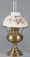 Two Brass Rayo lamps with a transfer decorated shade and an emerald shade