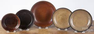 Five redware platesshallow bowls