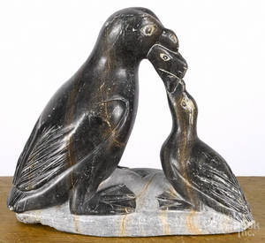 Inuit carved soapstone penguin feeding young