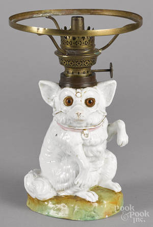 Miniature porcelain figural seated dog lamp 19th c