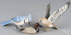 Miniature carved and painted peregrine falcon and blue jay