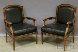 Pair of Chateau DAx Louis XVIstyle Black Leather Upholstered Carved Walnut Fauteuil