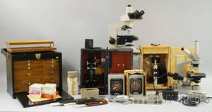 Four Modern Microscopes and Accessories
