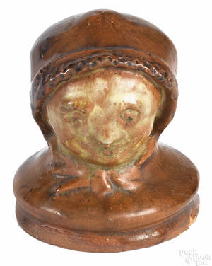Redware head of a lady with bonnet late 19th c